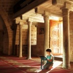 Name: Amani Sharqawi - Location: Palestine, Gaza - Date: 22 June 2015 - Title: Rituals of Childhood - Description: a child spontaneously trying to read Quran in one of the oldest mosques in Gaza